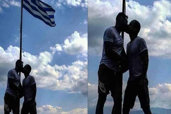 Χαμός: Αξιωματικός της ΕΛ.ΑΣ. φιλιέται με μετανάστη κάτω από την ελληνική σημαία! (photo)