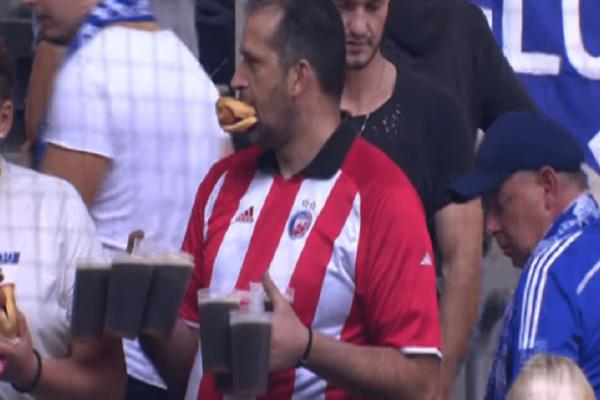 Επικό βίντεο: Ο απίστευτος φίλαθλος που κουβαλά με τα χέρια του 7 μπύρες και τρώει χοτ ντογκ!