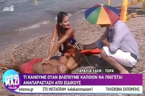 Επική εμφάνιση ρεπόρτερ με καπέλο-ομπρέλα! (Video)