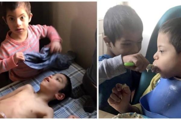 Παιδί 4 ετών με σύνδρομο Down φροντίζει τα τρία ανάπηρα αδέλφια του και συγκινεί το διαδίκτυο!