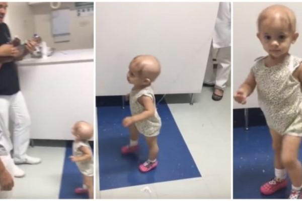 Αυτό το μικρό κοριτσάκι με καρκίνο χαμογελάει για πρώτη φορά όταν της τραγούδησε ο γιατρός της! (Video)